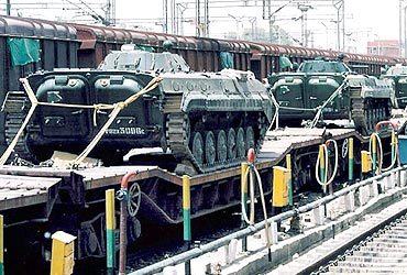 Indian tanks sit on train carriages, waiting to be dispatched to Kashmir