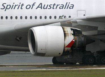 Qantas Airways A-380 passenger plane QF32 with its partially damaged engine sits on the tarmac after making an emergency landing at Changi airport in Singapore
