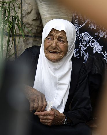 Zahiya Hamoushi, a villager, reacts during clashes between Lebanese and Israeli soldiers at Adaisseh village, southern Lebanon
