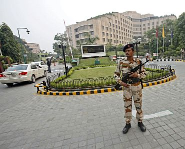 A paramilitary soldier stands guard outside the Hotel Maurya Sheraton in New Delhi