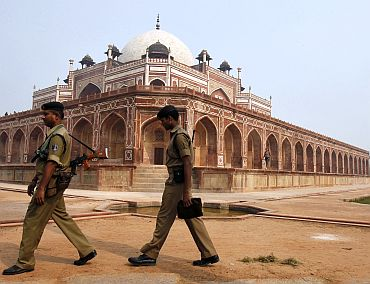 Security personnel keep watch inside the lawns of Humayun's Tomb in New Delhi