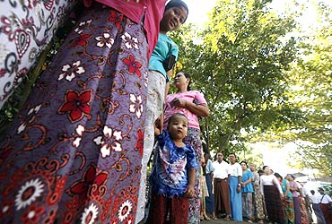 Voters wait to cast their ballots at a polling station in Sittwe, Rakhine state in Myanmar