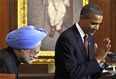 US President Obama greets lawmakers beside PM Dr Singh after delivering a speech at Parliament