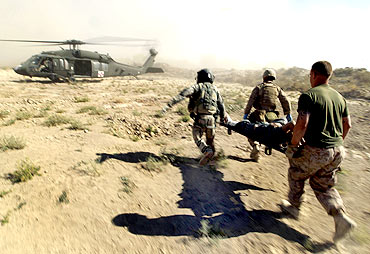 US Marines carry an injured Afghan national to a helicopter during a mission in southern Afghanistan's Helmand province