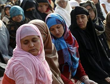 Kashmiri women offer prayers during the Eid al-Adha festival in Srinagar