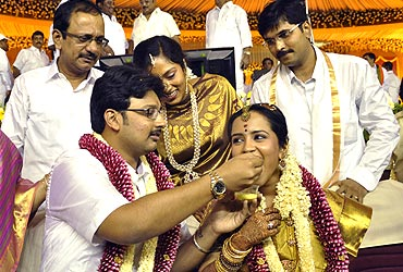 The groom, Durai Dayanidhi Azhagiri feeds his bride