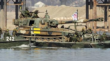 Soldiers from a South Korean army armoured division take part in an annual river-crossing exercise against a possible attack from North Korea on the Han river in Yeoju