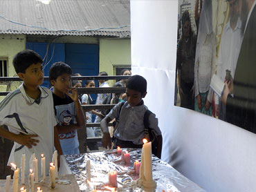 Colaba children gaze at the candles lit in memory of Gavriel and Rivka Holtzberg