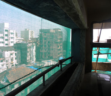 A view of Colaba from an upper floor of Nariman House. A hole ripped from the exterior by grenades