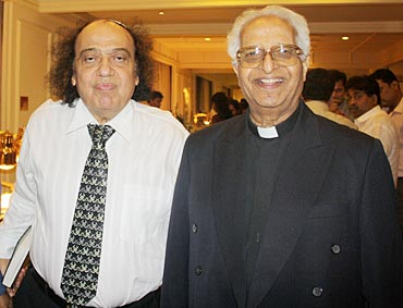 Solomon Sopher (left) and Fr Anthony D'Souza (right) attend the function