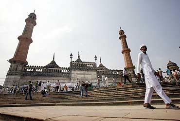 Muslims leave after Friday prayers at a mosque in Lucknow