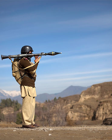 A Pakistani soldier with a rocket launcher on the Afghan-Pakistan border