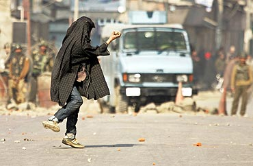 A file photo of Kashmiri stone-thrower in action