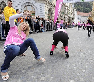 Participants pick themselves up after falling in a high heels race organised by a woman's magazine in Ljubljana's old city centre on October 2. Twenty contestants competed in the race, which is in its fourth year running, wearing heels at least 8 cm (3.15 inch) high