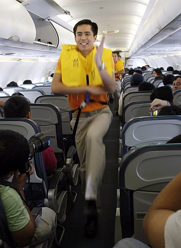 Cebu Pacific airlines cabin crew dance during a safety demonstration routine with the tune of 'Safety Dance' on a domestic flight to Davao city, southern Philippines. Cebu Air received some well-timed publicity this week when a video of its flight attendants dancing a safety demonstration routine racked up more than 6 million hits in five days after it was posted on the Internet. Airline representatives said they want to make their flights fun and help passengers pay attention to the demonstration