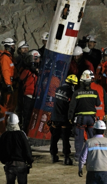 The capsule that will carry the trapped miners to safety is lowered with rescue expert Manuel Gonzalez inside