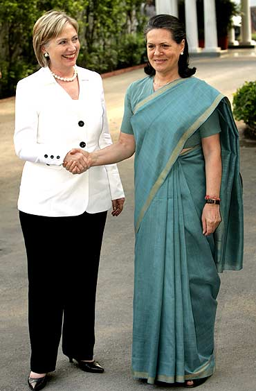2 powerful female politicians: US Secy of State Hillary Clinton with Congress chief Sonia Gandhi