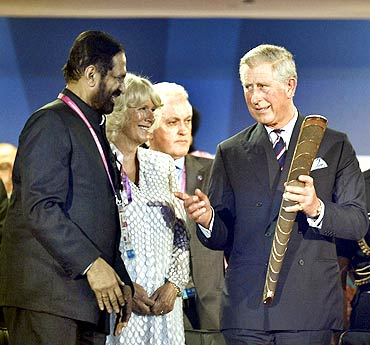 Suresh Kalmadi interacts with Britain's Prince Charles and Duchess of Cornwall Camilla Parker Bowles during the opening ceremony of the Games amid boos from the packed crowd at the Jawaharlal Nehru Stadium