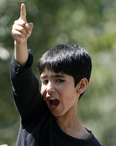 A boy shouts pro-freedom slogan during an anti-India protest in Srinagar