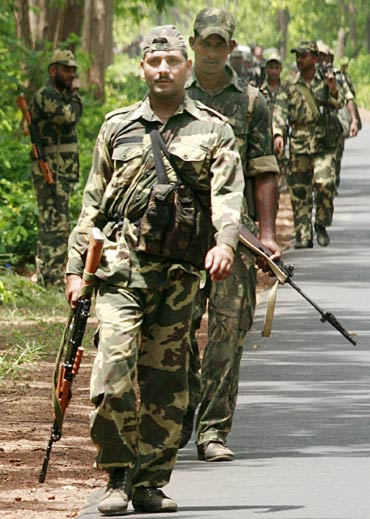 Paramilitary soldiers patrol at Jhitka near Lalgarh in the West Midnapore district, some 170 km west of Kolkata