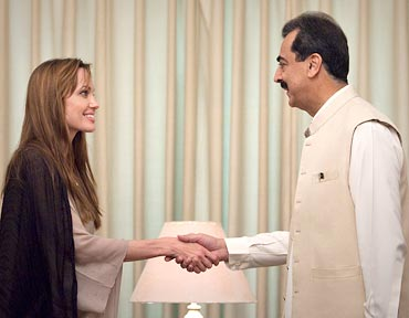 Actress Angelina Jolie with Pakistan PM Yusuf Raza Gilani