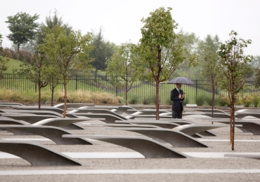 A man stands at the September 11th memorial at the Pentagon