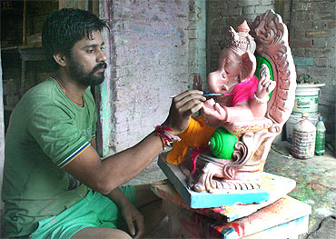 A traditional Ganpati idol at a workshop in Pen