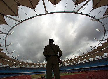 A policeman guards a CWG stadium in Delhi. The CWG panel is facing corruption charges worth crores