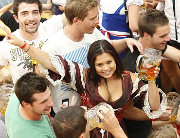 People toast with beer during the opening day of the 177th Oktoberfest in Munich September 18, 2010