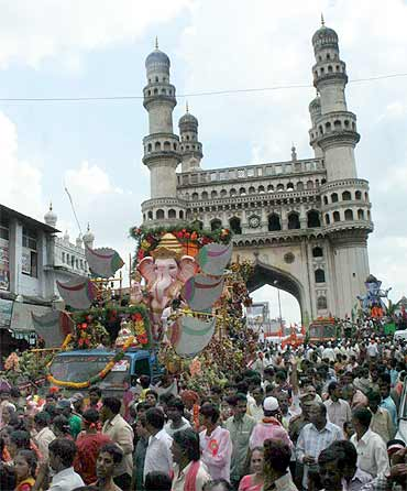 Massive Ganesh immersion processions pass near the Charminar in Old Hyderabad on Wednesday