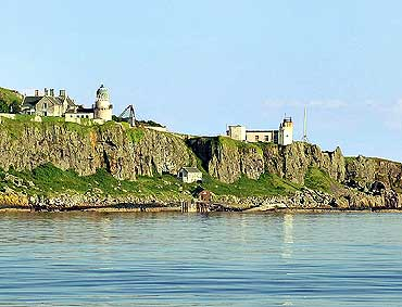 Little Cumbrae island has a few buildings, a castle in ruins, a mansion, a lighthouse and cottages