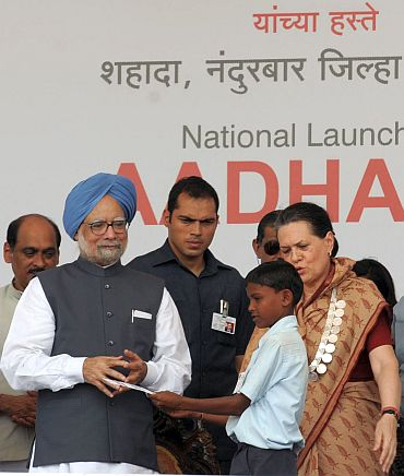 Prime Minister Manmohan Singh launches the Aadhaar Number under Unique Identification Authority of India, at Tembhali village, Nandurbar, Maharashtra on September 29 alongwith Congress President Sonia Gandhi