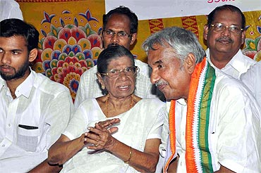 Oommen Chandy with K R Gowri Amma at a rally in Alleppey