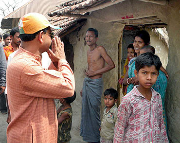 Abhijit Mukherjee interacts with villagers during his campaign trail in Pakha