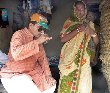 Mukherjee takes a break from his campaign in Pakha village