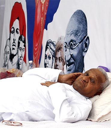 Social activist Anna Hazare rests during a fast unto death campaign in New Delhi