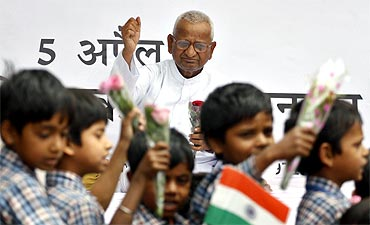 School children participate in a rally showing support to Hazare