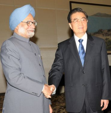 Prime Minister Manmohan Singh with Chinese President Hu Jintao, after a bilateral meeting on the sidelines of the BRICS Summit at Sanya, China