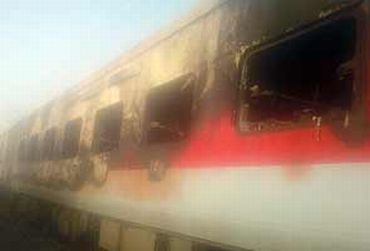 A video grab shows the burnt coaches of the Mumbai-Delhi Rajdhani