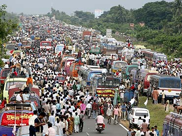 Left Front supporters block a national highway in support of the Tata car project at Singur village
