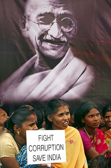 Supporters of Anna Hazare hold placards during a protest against corruption in Hyderabad