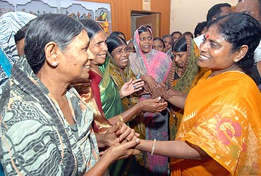Jagan's mother Vijaylaxmi (right) with her supporters