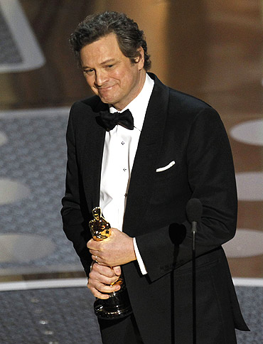 British actor Colin Firth accepts the Oscar for best actor for his role in The King's Speech