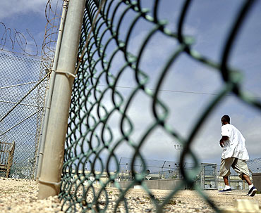 A detainee runs inside an exercise area at the detention facility at Guantanamo Bay