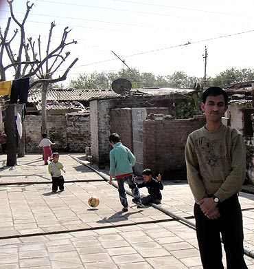 Vinod Dhar outside his present accommodation in the Jammu refugee camp