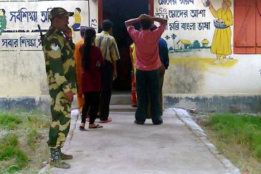 A CRPF jawan guards a polling booth in Kolkata's Jadavpur constituency on Wednesday morning