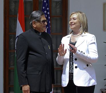US Secretary of State Clinton speaks with Foreign Minister S M Krishna during a photo call before their meeting in New Delhi