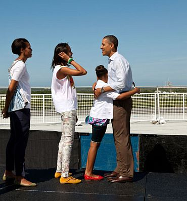 President Barack Obama, First Lady Michelle Obama and daughters Sasha and Malia stand on the viewing platform where they would have watched the launch of the Space Shuttle Endeavor at the Kennedy Space Center in Cape Canaveral