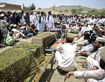 Family members mourn during a mass funeral of civilians killed in US drone strikes in Miranshah, Pakistan