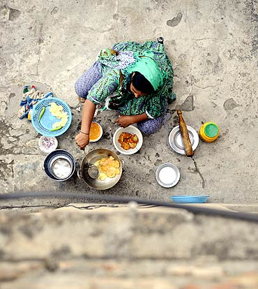 A woman prepares iftar, the evening meal for breaking fast, in the courtyard of her home in Islamabad